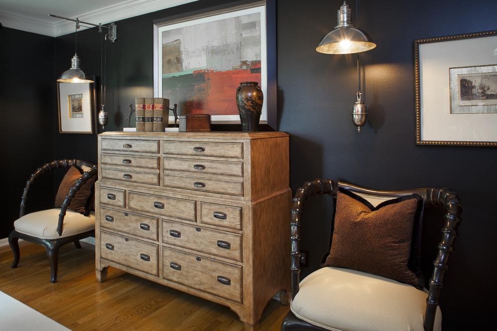 Mountain style medium tone wood floor bedroom photo in Kansas City with black walls