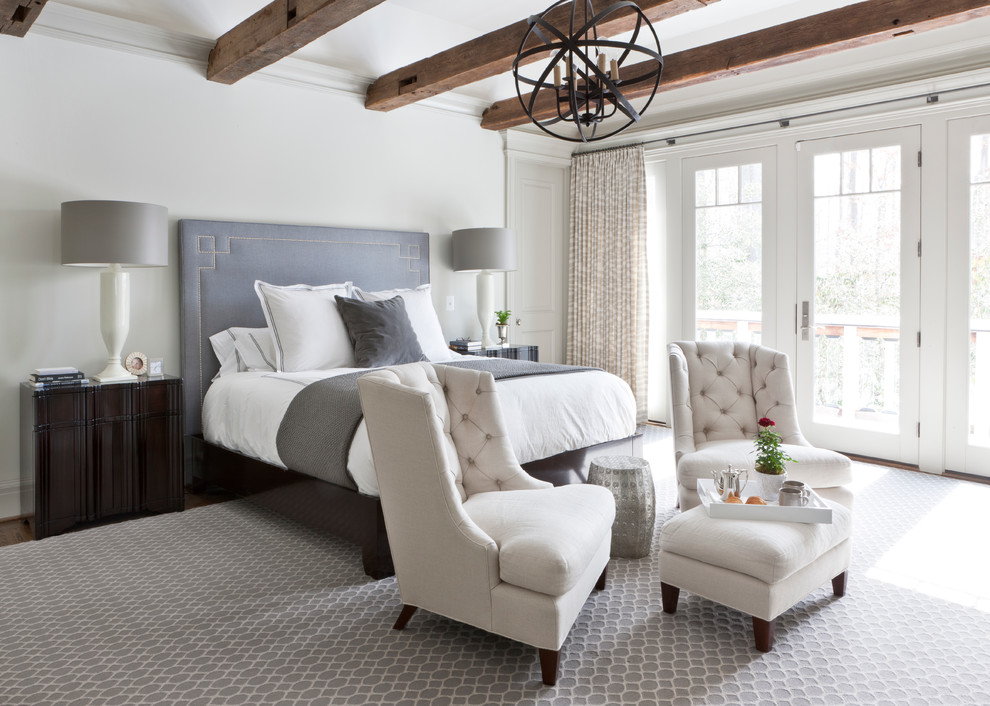 Example of a transitional master bedroom design in DC Metro with white walls