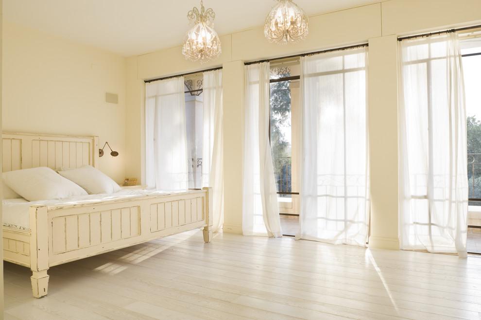 Inspiration for a mediterranean master light wood floor and beige floor bedroom remodel in Tel Aviv with beige walls