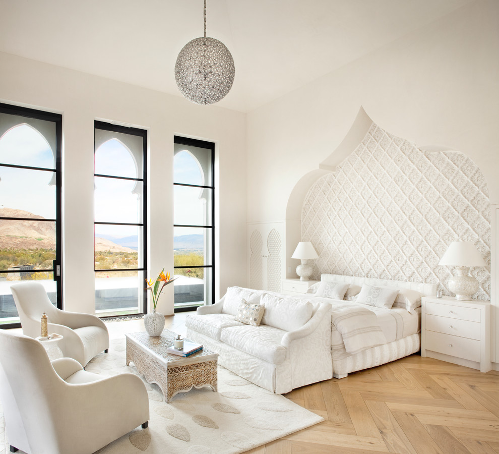 Inspiration for a transitional light wood floor bedroom remodel in Other with white walls
