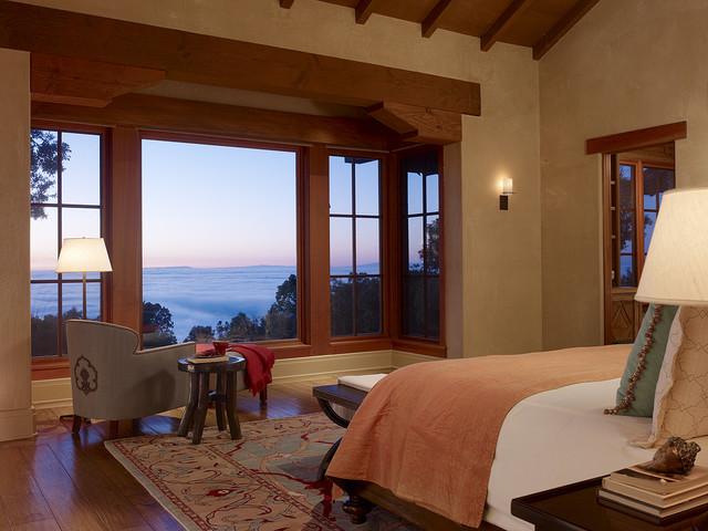 Tuscan dark wood floor bedroom photo in San Francisco with beige walls