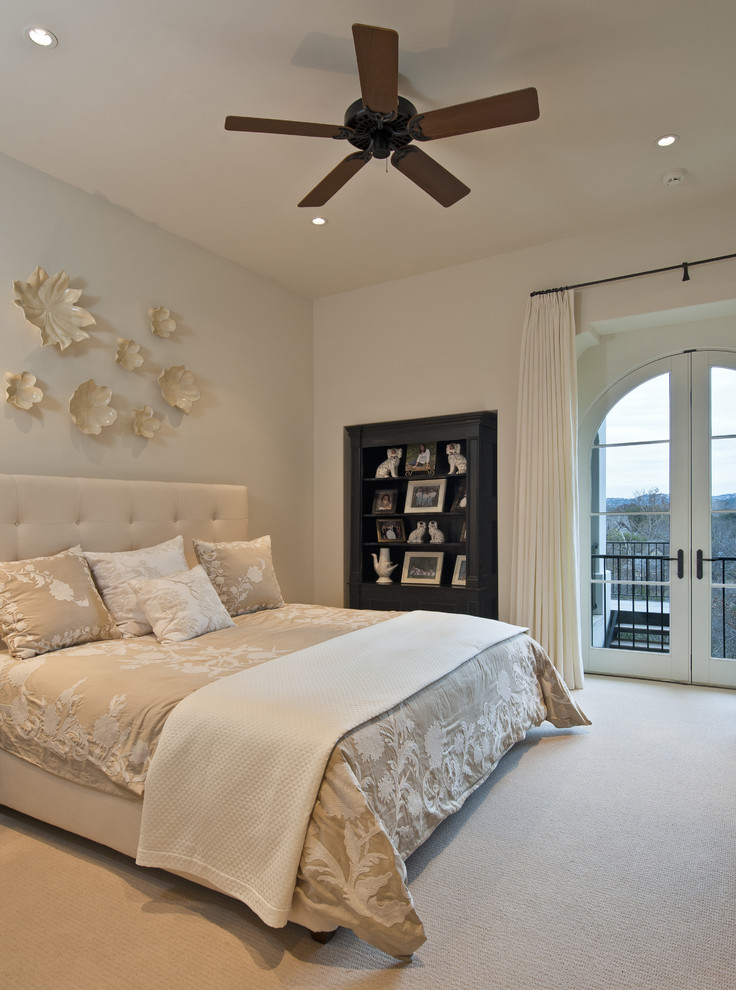 Bedroom - contemporary carpeted bedroom idea in Austin with beige walls