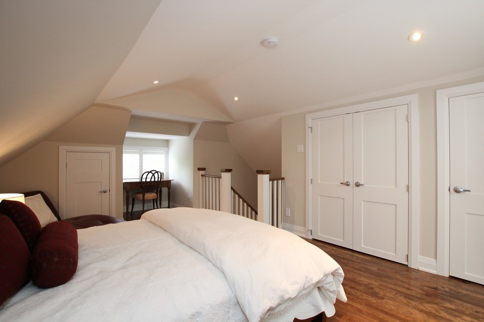 Example of a mid-sized transitional loft-style dark wood floor and brown floor bedroom design in Other with beige walls