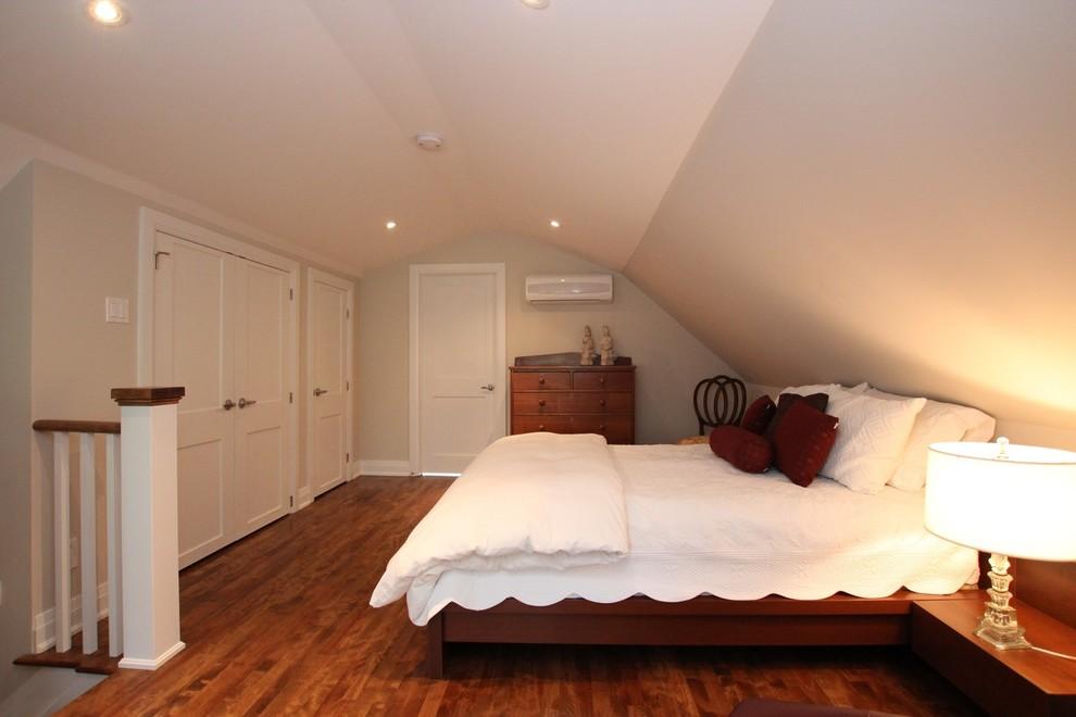 Bedroom - mid-sized transitional loft-style dark wood floor and brown floor bedroom idea in Other with beige walls