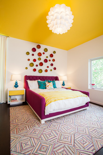 Inspiration for a contemporary bedroom remodel in Houston with white walls