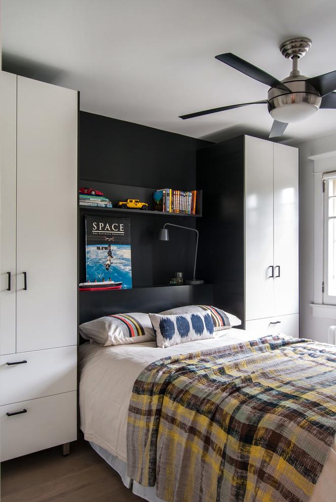 Bedroom - contemporary bedroom idea in Toronto with black walls