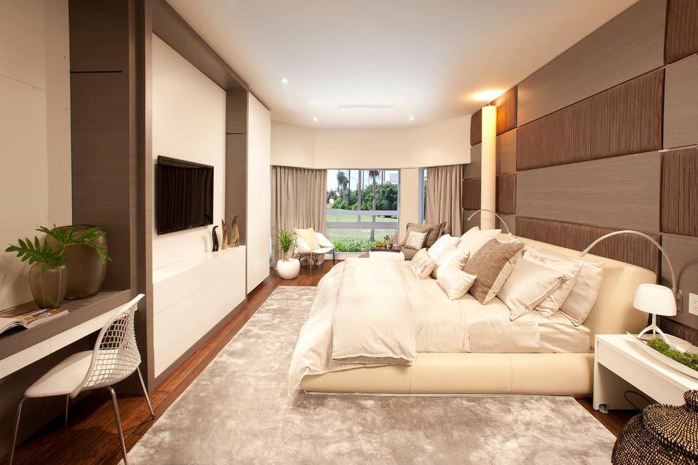Transitional medium tone wood floor bedroom photo in Miami with beige walls