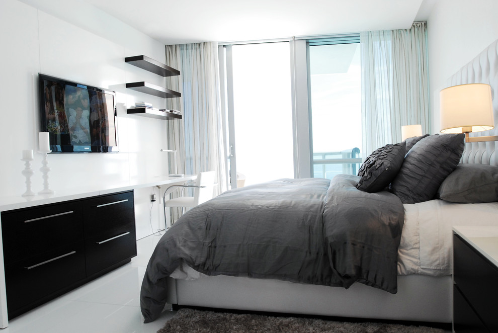Inspiration for a contemporary bedroom remodel in Miami with white walls