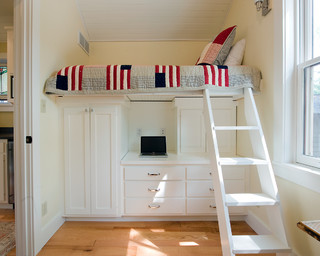 Bed with storage cabinets below.