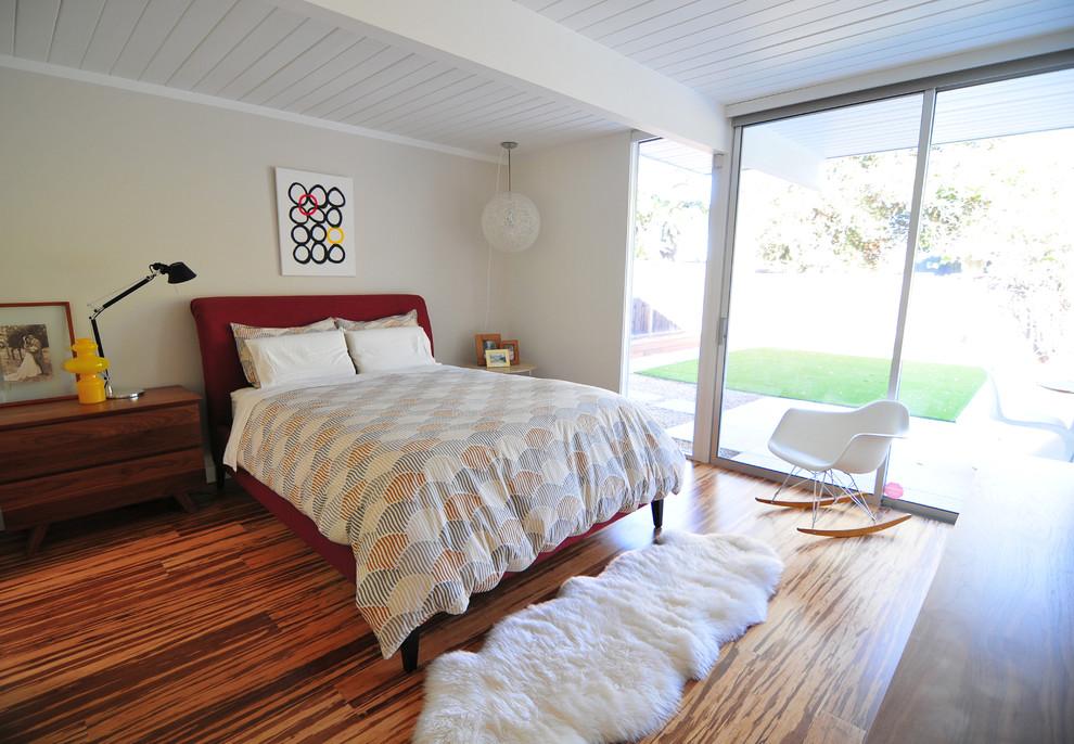 Bedroom - 1950s bamboo floor bedroom idea in San Francisco with beige walls