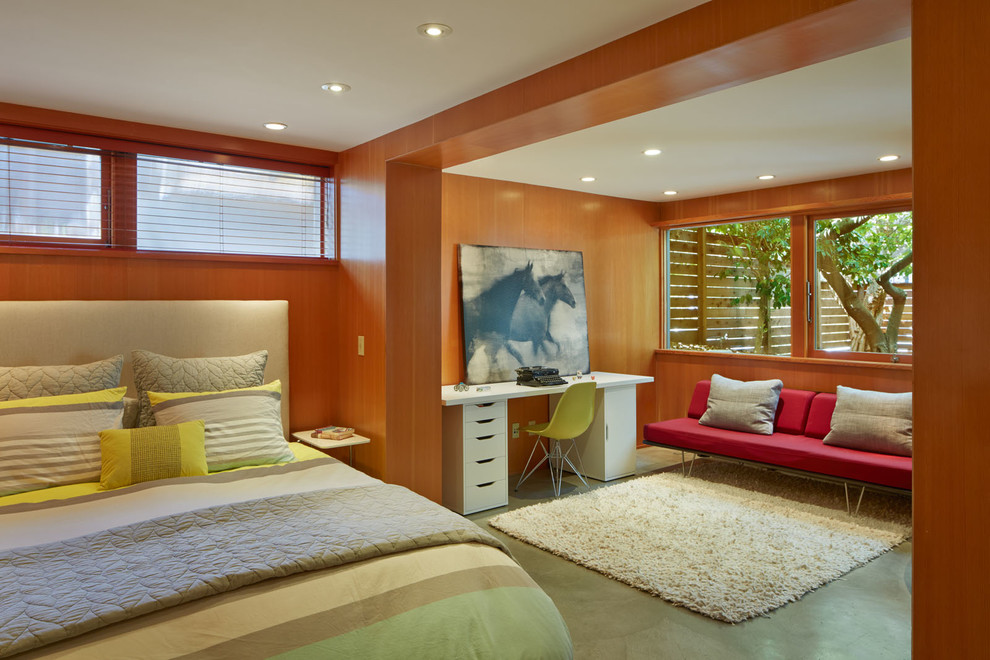 Example of a small 1960s master concrete floor bedroom design in San Francisco with brown walls