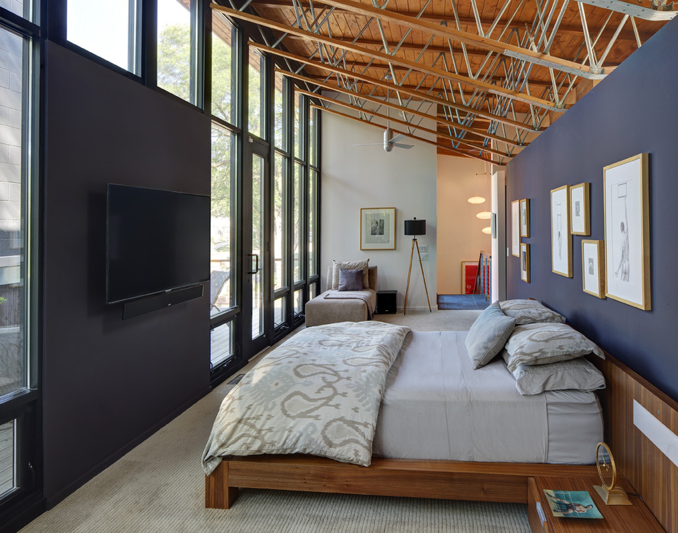 Large trendy loft-style carpeted and gray floor bedroom photo in Milwaukee with blue walls and no fireplace