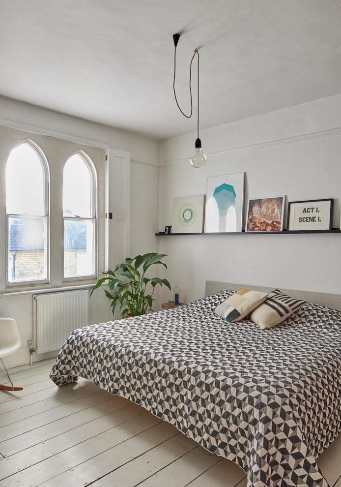 Bedroom - mid-sized scandinavian painted wood floor and beige floor bedroom idea in Essex with white walls