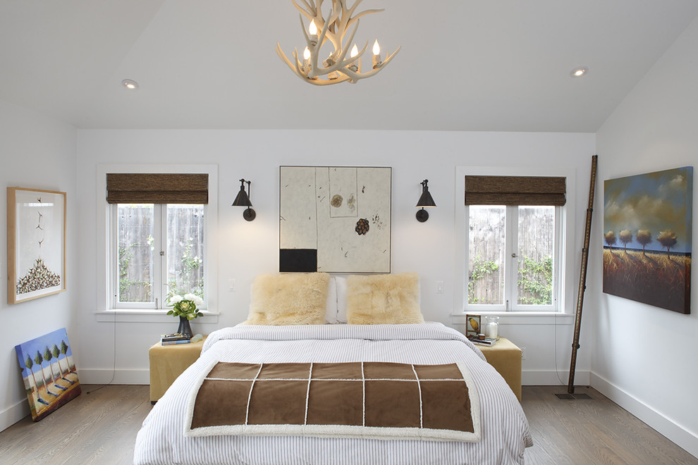 Example of a trendy light wood floor bedroom design in San Francisco with white walls and no fireplace