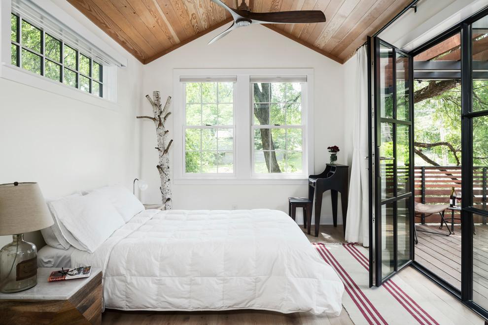 Bedroom - cottage light wood floor and beige floor bedroom idea in Austin with white walls