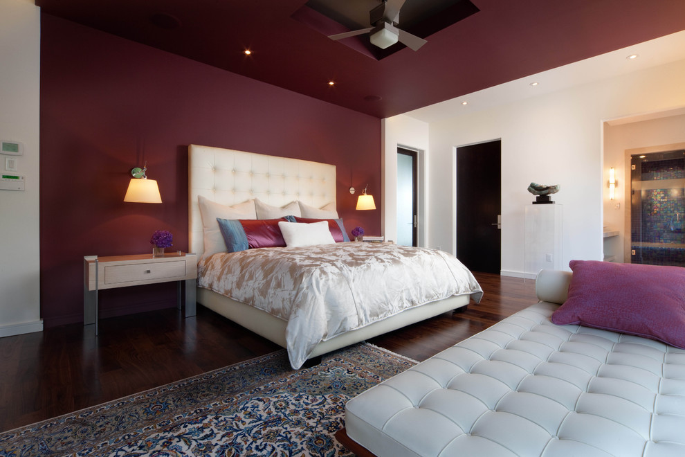 Example of a minimalist bedroom design in Orlando with purple walls