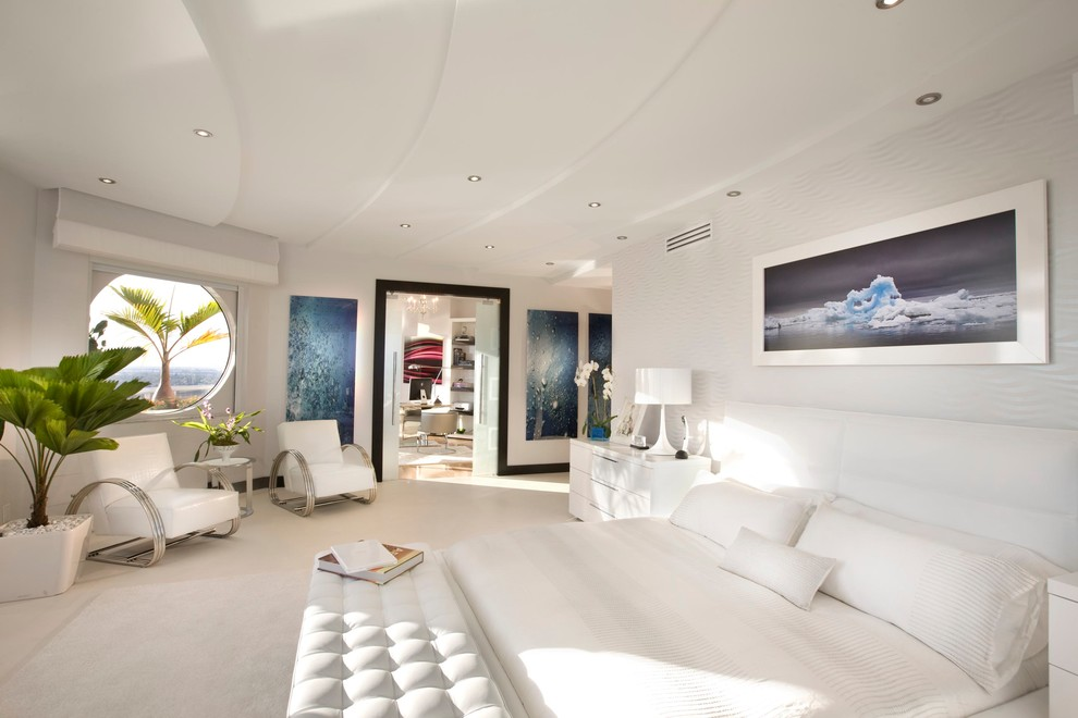 Example of a minimalist carpeted bedroom design in Miami with white walls