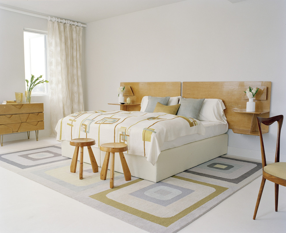 Inspiration for a modern white floor bedroom remodel in New York with white walls