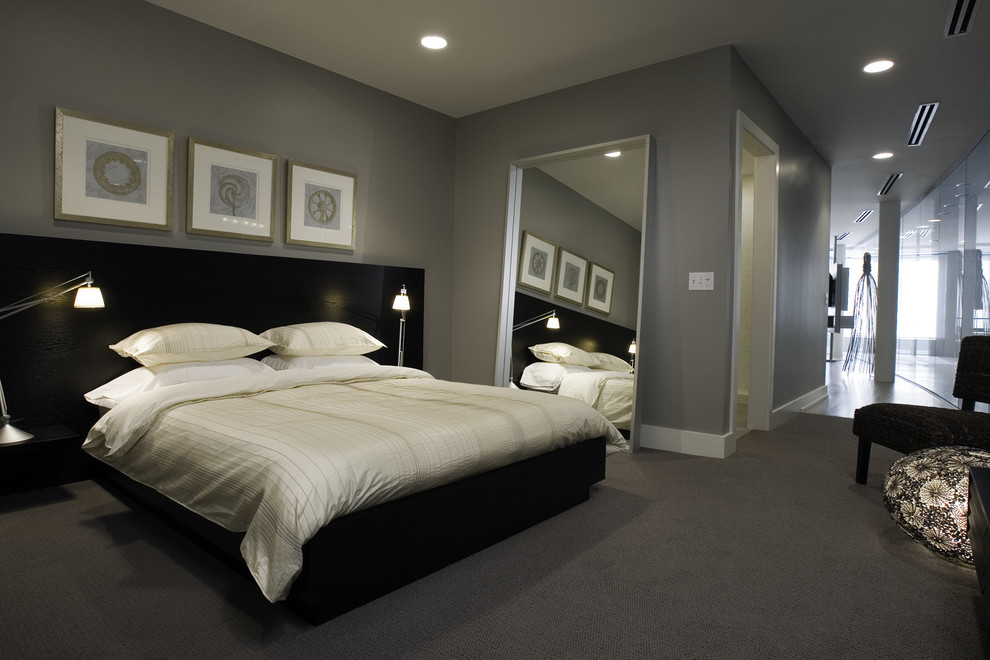 Example of a classic carpeted bedroom design in Chicago with gray walls