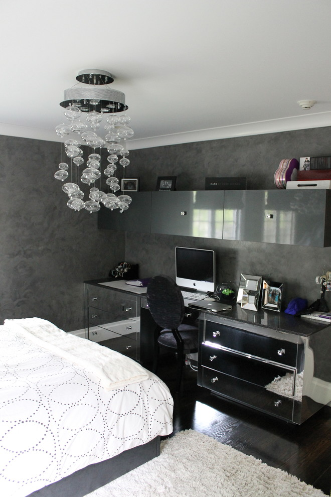 Example of a mid-sized minimalist guest dark wood floor bedroom design in New York with black walls