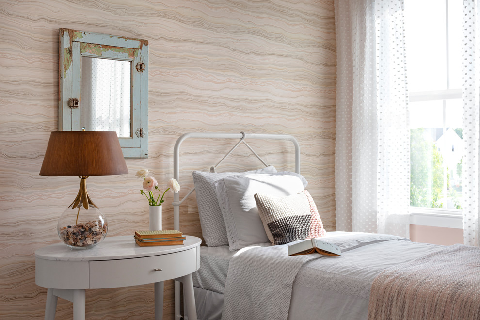 Inspiration for a mid-sized cottage guest dark wood floor and brown floor bedroom remodel in DC Metro with pink walls