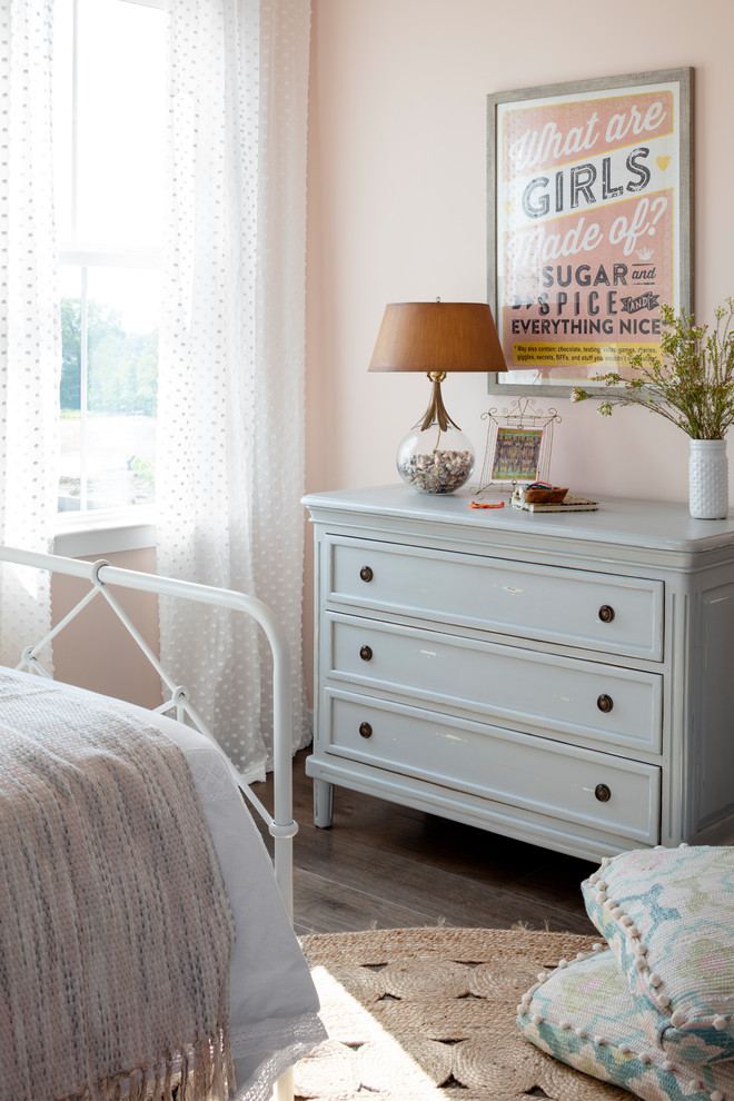Bedroom - mid-sized country guest dark wood floor and brown floor bedroom idea in DC Metro with pink walls