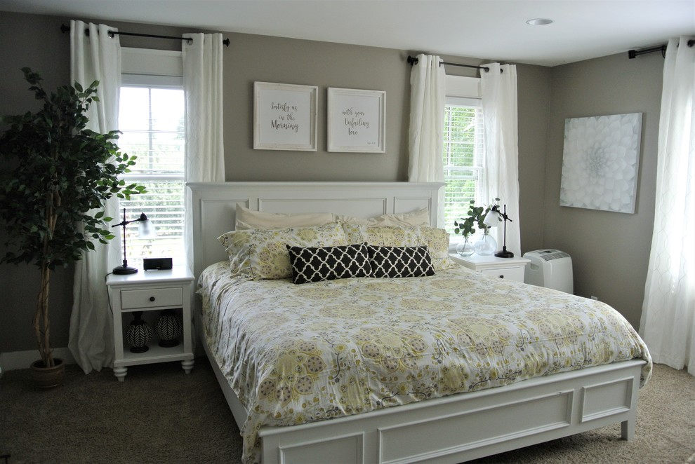 Example of a large cottage master carpeted bedroom design in Grand Rapids with gray walls