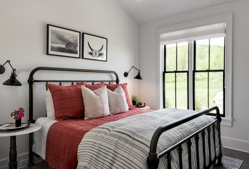 Bedroom - large farmhouse guest dark wood floor and brown floor bedroom idea in New York with white walls