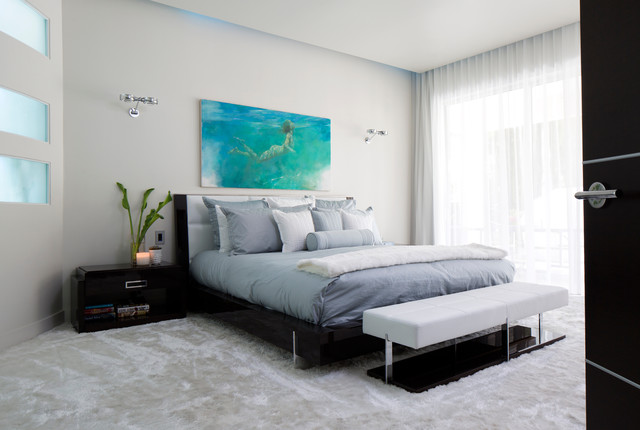 example of a trendy master carpeted bedroom design in orlando with gray walls