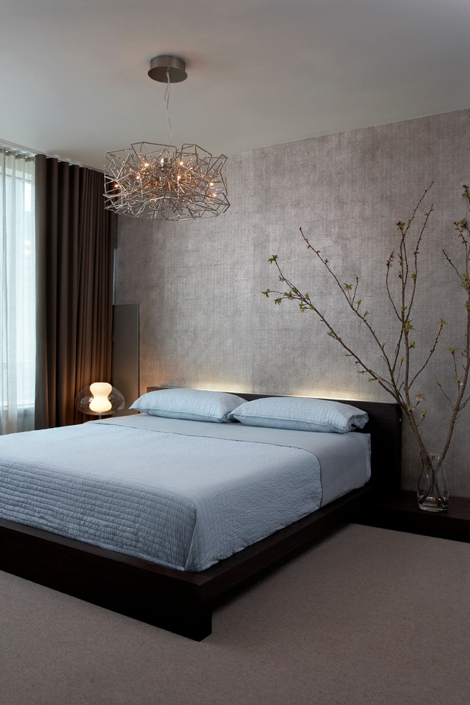 Inspiration for a contemporary carpeted bedroom remodel in Chicago with gray walls and no fireplace