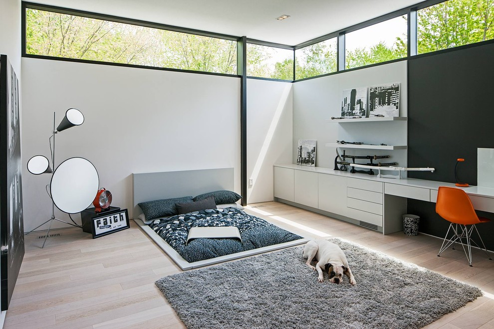 Example of a danish bedroom design in Toronto with white walls