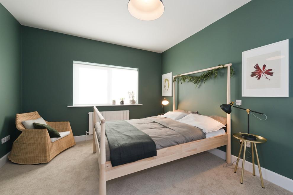 Bedroom - mid-sized scandinavian guest carpeted and beige floor bedroom idea in Dublin with green walls