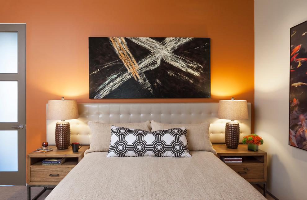 Example of a mid-sized trendy bedroom design in Los Angeles with orange walls