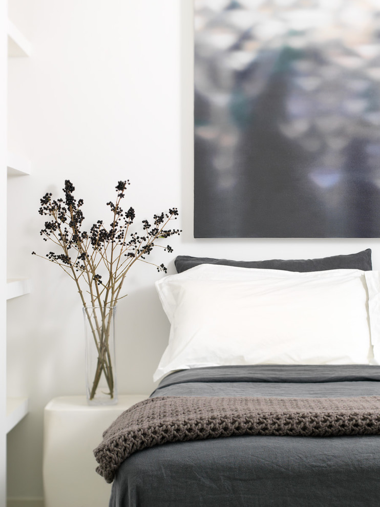 Small urban guest concrete floor and gray floor bedroom photo in Toronto with white walls