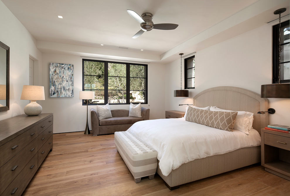 Inspiration for a large mediterranean guest carpeted bedroom remodel in Santa Barbara with white walls and no fireplace