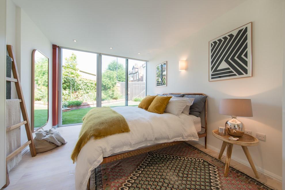 Bedroom - contemporary beige floor bedroom idea in London with white walls