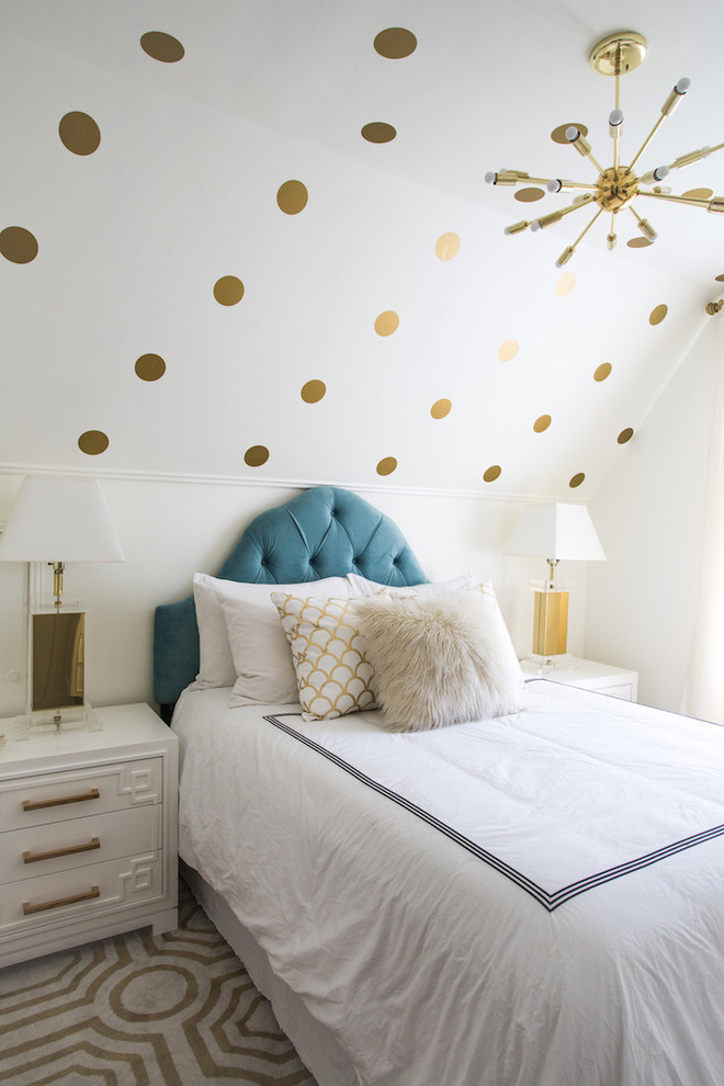 Bedroom - small transitional guest light wood floor bedroom idea in Los Angeles with white walls and no fireplace