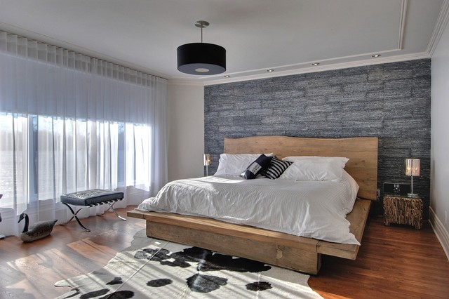 Example of a trendy master medium tone wood floor bedroom design in  Montreal with gray walls