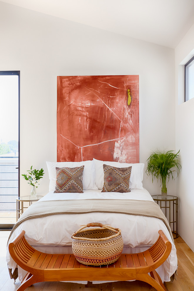 Inspiration for a contemporary guest medium tone wood floor bedroom remodel in Other with white walls