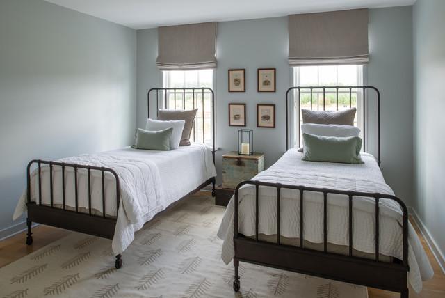Bedroom - mid-sized country guest medium tone wood floor and brown floor bedroom idea in DC Metro with blue walls