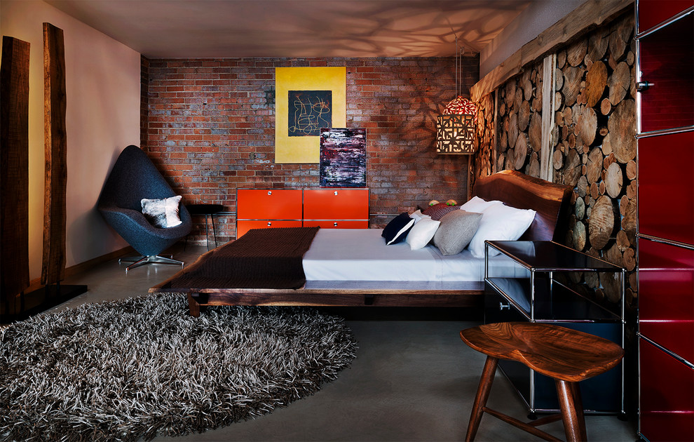 Example of an urban loft-style concrete floor bedroom design in Denver with no fireplace