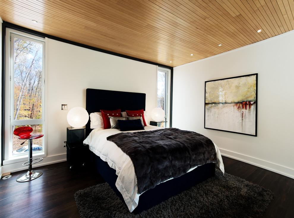 Bedroom - contemporary dark wood floor bedroom idea in Montreal with white walls