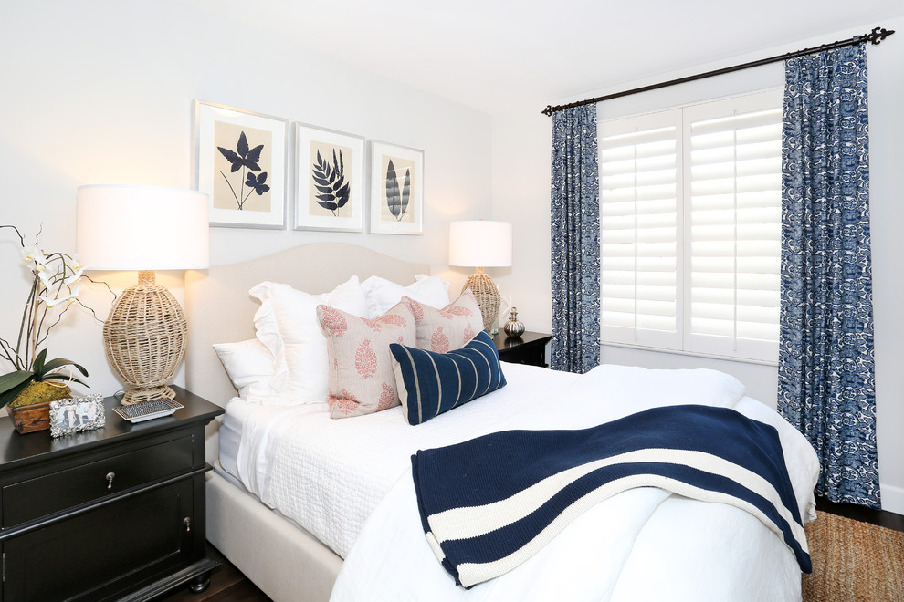 Inspiration for a coastal guest bedroom remodel in Orange County with white walls