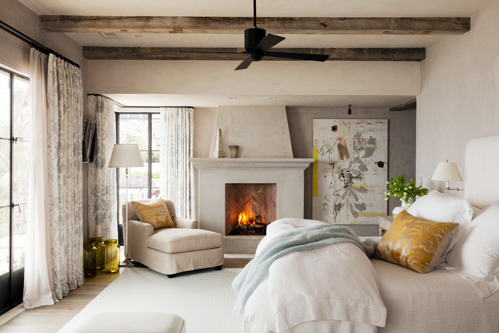 Bedroom - mediterranean master bedroom idea in Orange County with a standard fireplace