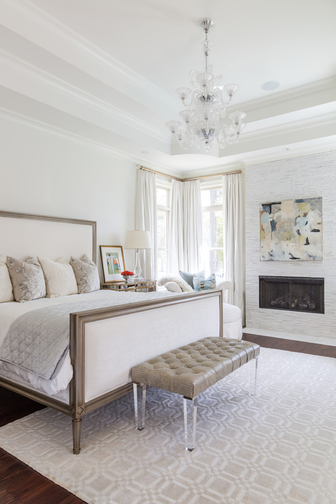 Example of a large classic master dark wood floor bedroom design in New Orleans with white walls and a ribbon fireplace