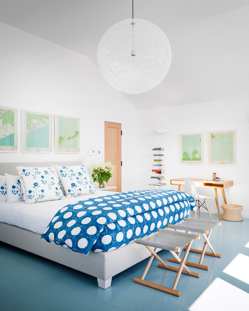 Bedroom - large coastal master painted wood floor and blue floor bedroom idea in New York with white walls and no fireplace