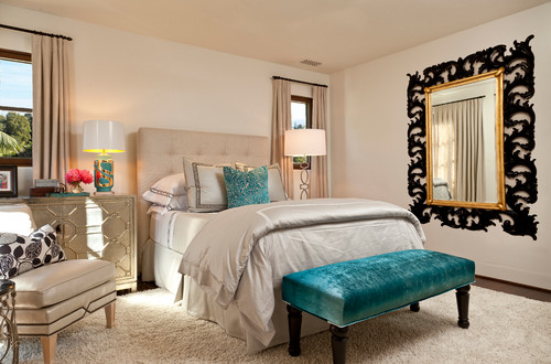 The gold framed mirror adds a unique dimension to this bedroom. The design  of the frame is simple but placing the mirror before a larger black frame  with ...