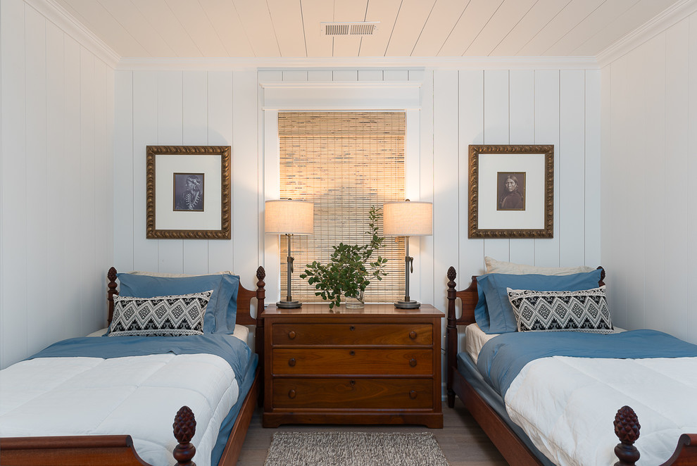 Bedroom - mid-sized cottage guest medium tone wood floor and brown floor bedroom idea in Other with white walls and no fireplace