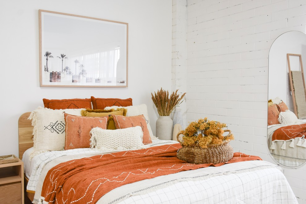Inspiration for a large mediterranean bedroom remodel in Sunshine Coast with white walls