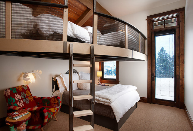 Mountain style loft-style carpeted bedroom photo in Other with white walls